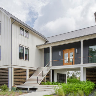 Cottage white two-story metal exterior home photo in Charleston with a metal roof