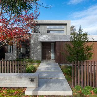 Design ideas for a contemporary two-storey grey exterior in Melbourne with a flat roof and mixed siding.