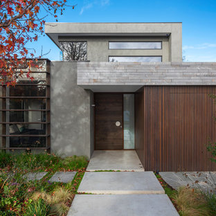 Inspiration for a contemporary two-storey grey exterior in Melbourne with a flat roof.