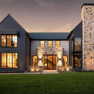 Inspiration for a farmhouse black two-story mixed siding exterior home remodel in Dallas with a metal roof