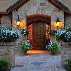 Traditional Exterior by Designscapes Colorado Inc.