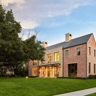 Example of a large transitional brown two-story brick exterior home design in Dallas with a metal roof