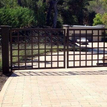 Bi-parting swing gate