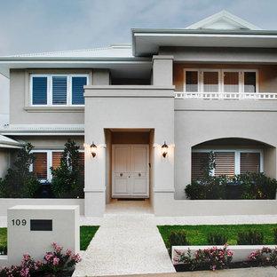 На фото: большой, двухэтажный, серый дом в классическом стиле с входной группой