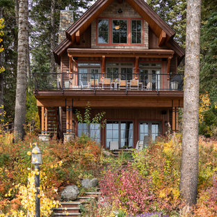 Rustic brown three-story wood gable roof idea in Boise