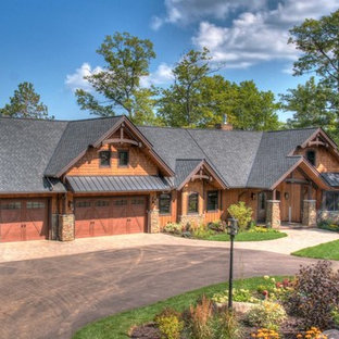 Example of a mountain style brown one-story mixed siding exterior home design in Minneapolis with a shingle roof