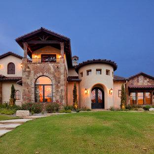 Tuscan brick exterior home photo in Austin