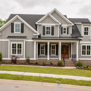 Large craftsman gray two-story mixed siding exterior home idea in Atlanta with a mixed material roof