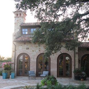 Inspiration for a mediterranean brick exterior home remodel in Austin