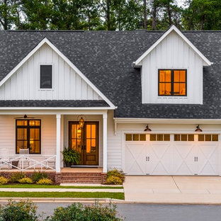 Large farmhouse white two-story gable roof photo in Cincinnati with a shingle roof