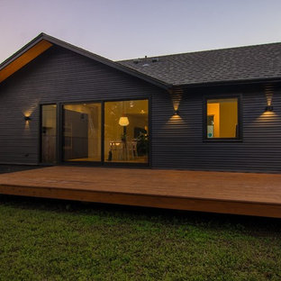 Example of a small danish black one-story wood exterior home design in Austin with a shingle roof