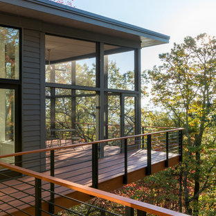Mid-sized mountain style gray two-story wood flat roof photo in Other