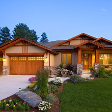 Traditional Exterior by Stone Aspen Signature Builders
