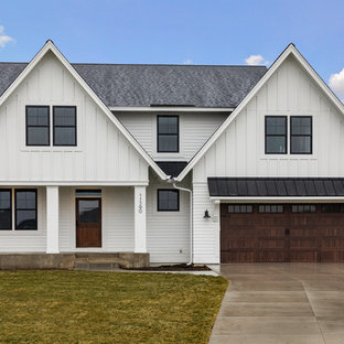 Country white two-story vinyl exterior home idea in Minneapolis with a shingle roof