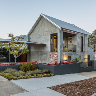 Inspiration for a contemporary two-storey concrete grey exterior in Perth with a gable roof.