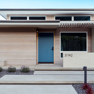 Small 1960s beige one-story mixed siding exterior home idea in Orange County
