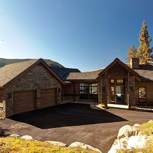 Example of a large transitional brown two-story stone exterior home design in Denver with a shingle roof
