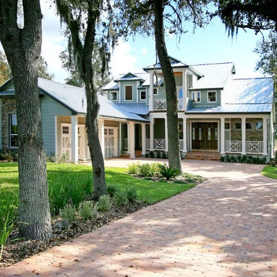 Inspiration for a large timeless blue two-story mixed siding exterior home remodel in Orlando