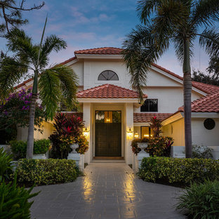 Example Of A Tuscan White Two Story Exterior Home Design In Miami With A Hip