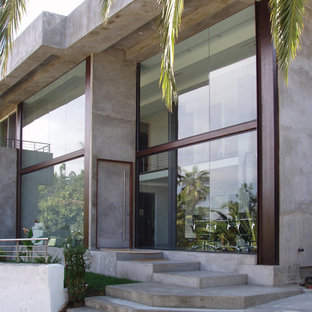 Inspiration for a large modern two-story concrete exterior home remodel in Los Angeles