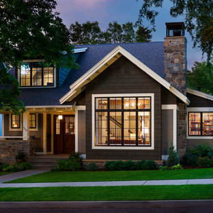 Elegant gray two-story wood gable roof photo in Other