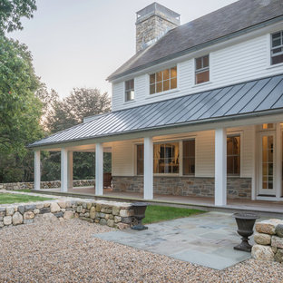 Inspiration for a farmhouse white two-story wood exterior home remodel in Philadelphia