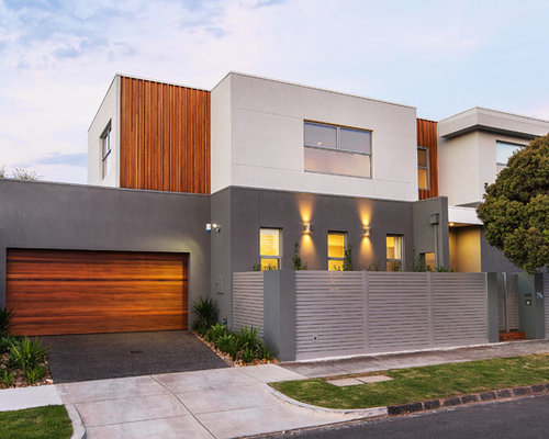 exterior contemporary house colors. inspiration for a contemporary two-story mixed siding flat roof remodel in melbourne exterior house colors