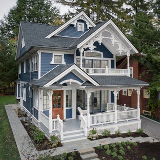 Inspiration for a victorian blue two-story gable roof remodel in Orange County with a shingle roof