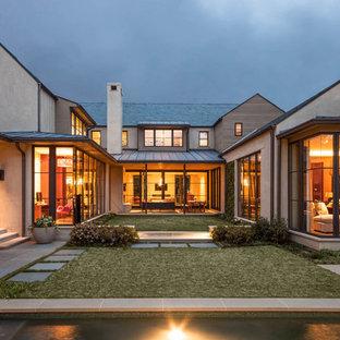 Example of a trendy concrete exterior home design in Dallas