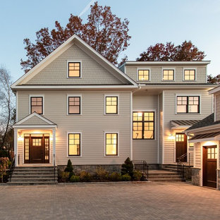 Example of a transitional gray three-story mixed siding house exterior design in New York