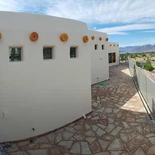 Large southwest beige one-story stucco flat roof photo in Las Vegas
