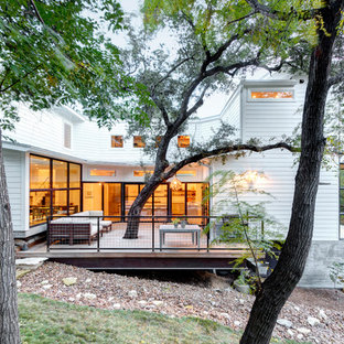 Large transitional white two-story wood exterior home idea in Austin