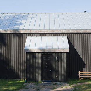 Mountain style metal exterior home photo in New York with a metal roof