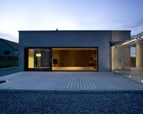 Example Of A Minimalist One Story Exterior Home Design In Dublin