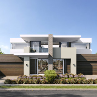 Example of a mid-sized minimalist white two-story concrete fiberboard exterior home design in Melbourne with a metal roof