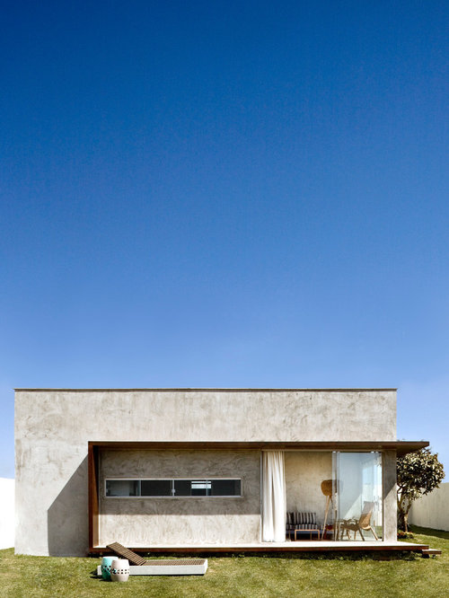 Inspiration for a modern gray one-story flat roof remodel in Other