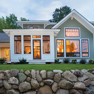 Arts and crafts two-story house exterior photo in Other with a shingle roof