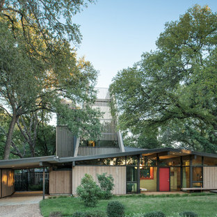 This is an example of a midcentury one-storey exterior in Austin with wood siding and a gable roof.