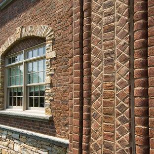Tuscan brown brick exterior home photo in Philadelphia