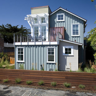 Example of a coastal wood exterior home design in San Francisco