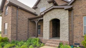 Brick and Stone Two Story with Neighborhood Amenities