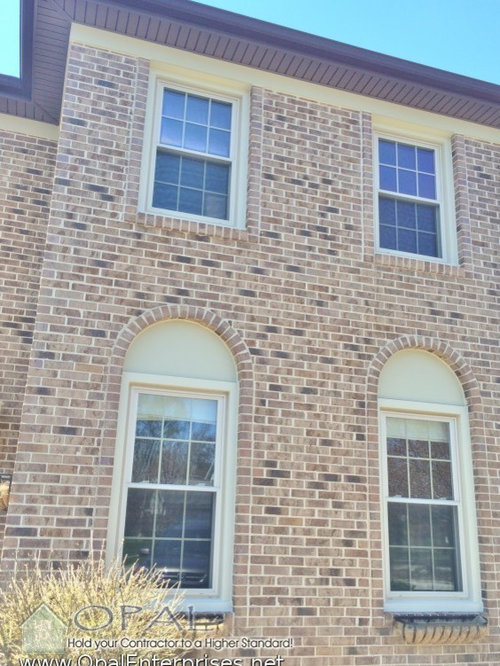 Brick Front Home With Arch Top Hardie Panels And Alside