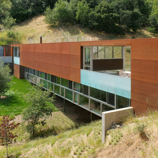 Industrial two-story metal flat roof idea in San Francisco