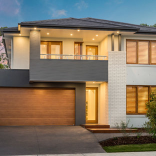 This is an example of a large contemporary two-storey white exterior in Brisbane with mixed siding.