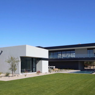 Inspiration for a large southwestern multicolored two-story exterior home remodel in Phoenix