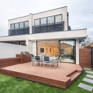 Inspiration for a mid-sized contemporary white two-story flat roof remodel in Melbourne