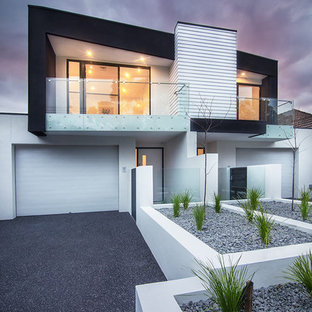 Inspiration for a contemporary two-storey multi-coloured duplex exterior in Melbourne with a flat roof.