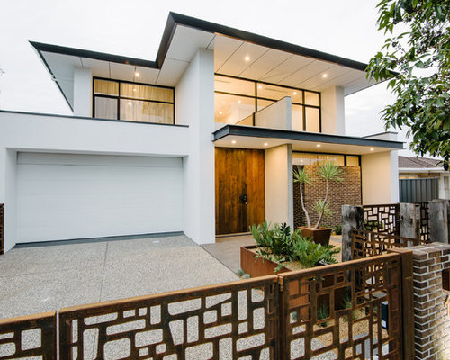 Example Of A Large Trendy White Two Story Mixed Siding Exterior Home Design  In Adelaide