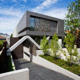 Imagen de fachada actual, grande, de dos plantas, con tejado plano