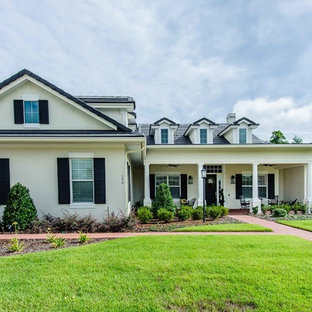 Inspiration for a mid-sized timeless two-story exterior home remodel in Orlando